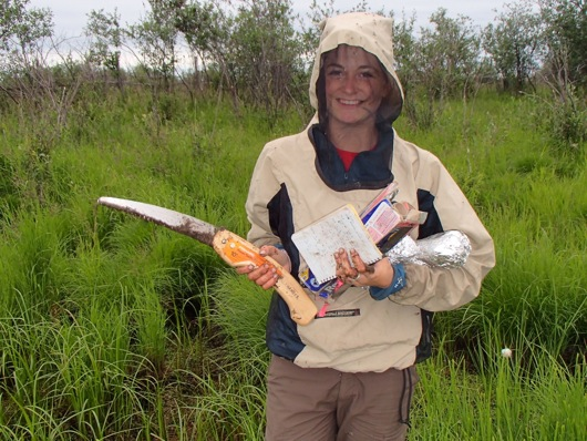 Dylan returns from soil sampling with her soil saw, field notebook, and newest soil samples.