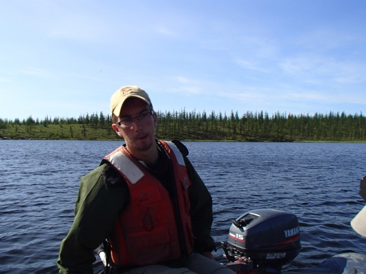 Seth guides our raft out to the sampling area on Shuch'ye Lake.